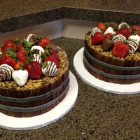 Barrel Cakes With Fresh Strawberries (Some Dipped In Chocolate) The barrel of the cakes were made with white Kit Kats that I turned around backwards and then painted brown to look like wood. Gray fondant...