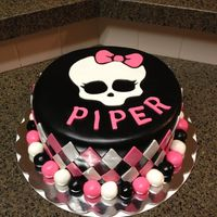 Monster High Cake is covered in fondant with fondant accents.