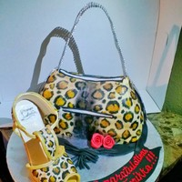 Louboutin Shoe And Purse Vanilla Cake And Edible Shoe Hand Painted Leopard Print The Strap Of The Purse Is Not Edible Louboutin shoe and purse - Vanilla cake and edible shoe. Hand painted leopard print. The strap of the purse is not edible.