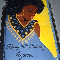 Afro/dashiki Cake Half Vanilla/Chocolate cake decorated with fondant accents.