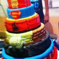 Super Hero Cake This is a 6 Tier cake. Vanilla and Chocolate. I made if for my boss who drove 10 hours to Mexico. I sent it separated (3 top tiers/3 bottom...
