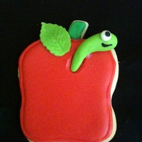 My 1St Decorated Cookie My 1st cookie - an apple. Gonna need some practice with these, but I had so much fun making it. Think the little worm is too cute! ;0)