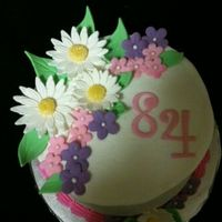 84Th Birthday Cake With Flowers   Made for my mother's 84th birthday. Simple little flowers, but she loved it. :-)