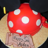 Pirate Mickey Pirate Mickey Head and requested by the customer. Everything edible. Chocolate cake filled chocolate ganache, iced in Almond BC and covered...