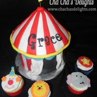 Circus Tent Cake With Circus Themed Cupcakes Circus tent cake with circus themed cupcakes.