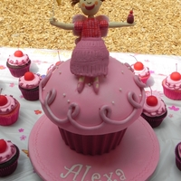 Pinkalicious giant pinkalicious cupcake to go along w/pinkalicious cupcakes for guests. Everything edible, including pinkalicious herself.