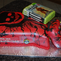 Gears Of War Groom's Cake Gears of War Groom's Cake. Cake covered in fondant with hand painted designs to look like this special edition XBOX console.
