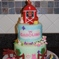 Farm Birthday Cake covered in fondant with fondant animals.