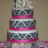 Damask Wedding Cake Using Royal icing this was done with a damask stencil from sugar craft.