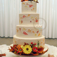 Autumn Wedding Cake   Ivory fondant with hand painted and piped falling leaves and handmade sugar decorations. Vanilla cake with vanilla buttercream