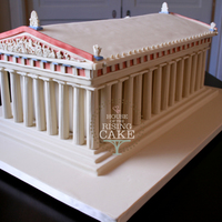 Parthenon Cake   Chocolate cake with chocolate buttercream. 50 servings. The cake is sitting inside the Parthenon but the roof is cake as well.