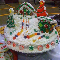 Gingerbread Snowy Village Cake This cake is decorated with little gingerbread houses and lots of different candies.