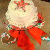 Christmas Star Cake Red Velvet cake with buttercream frosting and white chocolate.