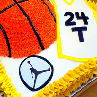 Basketball Themed Birthday Cake The cake is vanilla and is decorated with buttercream frosting. The Jersey was made with fondant.