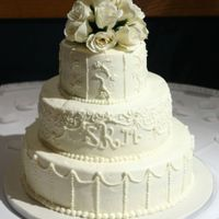 Satoshia 6,10,14 white BC icing and BC piping. silk flowers on teh top. thanks for looking, all comments appreciated!!