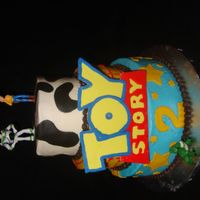 Toy Story Cake Reproduction of client photo but in buttercream instead of fondant. Figures are plastic. Toy Story Logo is fondant.