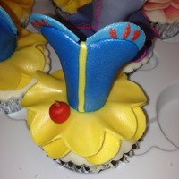 Disney Princess Dress Cupcakes Snow White, the original! You can see Rapunzel's dress in the background.
