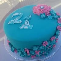 Teal And Pink 21St Birthday Cake Fondant with gumpaste flowers. The letters were created using a tutorial for swirled fondant I found online.