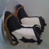 Cowboy Boots Boots are white cake with vanilla buttercream covered and decorated in fondant with a fondant rope. They didn't really turn out how I...
