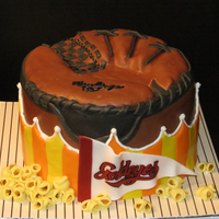Baseball Birthday   Chocolate buttermilk cake with Strawberry buttercream. Covered with MMF. All accessories MMF.