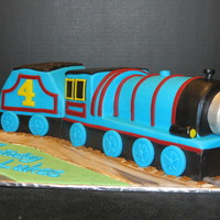 Gordon The Train   Chocolate Buttermilk cake with blue buttercream covered with Chocolate ganache and finished with MMF