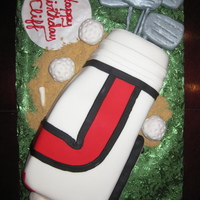 Golf Bag Cake Everything on this cake is edible. The clubs and the balls are made out of rice krispies and then covered with fondant. I loved doing this...