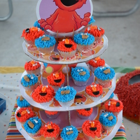 Elmo And Cookie Monster Mini Cupcakes For 1Rst Birthday Party The Eyes Are Dragees With Black Pupils Painted With Edible Markers The Cooki... Elmo and Cookie Monster Mini Cupcakes for 1rst Birthday party.The eyes are dragees with black pupils painted with edible markers. The...