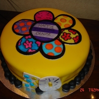 "Romero Britto Fondant Cake I made this for a surprise Birthday party. It is a 12"" vanilla rum cake with dulce de leche filling. The flower is a Fondant plaque..."
