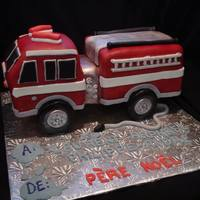 Fire Truck Cake all edible standing on wheels