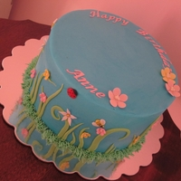Spring Birthday Buttercream iced cake with fondant accents