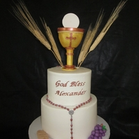 First Communion Buttercream iced cake with fondant accents