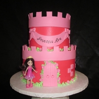 Pink Princess Castle   Buttercream iced cake, with fondant accents.