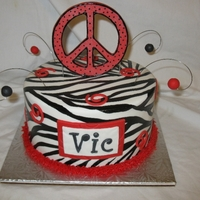 Zebra Peace And Swirls For Victoria Zebra stripes hand painted. Peace sign made of fondant/gumpaste mix with added tylose and is edible