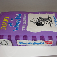Diary Of A Wimpy Kid made this cake for my son's class for scoring perfect scores in there practice TAKS tests. half chocolate and half vanilla covered in...