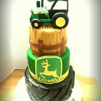 John Deere Tractor 3 tier cake covered in mmf. tractor made of rice crispy treats