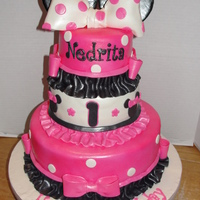 Minnie Mouse 3 tier minnie mouse cake all strawberry cake with strawberry filling, covered in mmf.