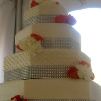 Bling & Tangerine 4-Tier Hexagon Cake This is my first hexagon, buttercream cake. I had so much fun with this. The bottom tier was white velvet cream cake with two layers of...