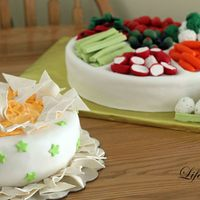 "Party Cake! - Veggie Tray With Dip Chips are modeling chocolate. Cheese dip is buttercream icing. Vegetables are modeling chocolate. Veggie tray is 12"" round single..."