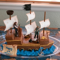 Pirate Ship! This was a chocolate cake with chocolate MMF. Most accessories were made with fondant. The characters are my son's fave toys. The...