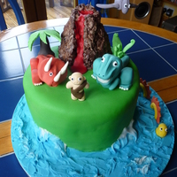 Dinosaur Island Cake  This was for a little boys 2nd birthday party and is my 2nd cake to date. All the dinosaurs and plants are made from fondant, the volcano...
