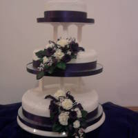Purple Roses My first ever wedding cake and my first attempt at making flowers. Please be gentle with any criticism but will still be appreciated as...