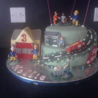 Fireman Sam Two tier vanilla sponge with vanilla buttercream fondant covered and fondant with tylose accents. Figures provided by Mum. For a little...