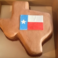 Texas Shaped Grooms Cake German chocolate cake, coconut filling and chocolate buttercream frosting.