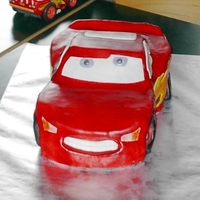 Lightening Mcqueen Cake Godfrey's 5th B-day- Super chocolate pudding cake w/rasp filling and marshmallow fondant. Also had a layer of Ganache for crumb coat....
