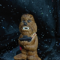 'chewbacca' From Starwars Sugar paste figurine of Chewy painted with gel colors, for a birthday cake.