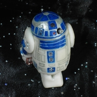 'r2-D2' From Starwars R2-D2 sugar paste figurine, painted with gel colors, (non-edible copper wire detail)