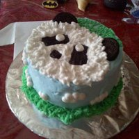 Panda Chocolate cake decorated with buttercream. Oreos for the ears.