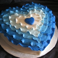 Blue Ruffle Vday Cake I love when a customer gives me free rein on the design. She just specified she didn't want something she could get at Wal-mart :) I...