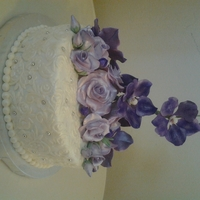 Lilac Roses And Purple Vanda Orchids Top tier for a cupcake stand.