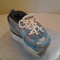 Sneaker Replica of my son's sneaker done for his birthday. Vanilla cake with coconut buttercream covered in mmf.